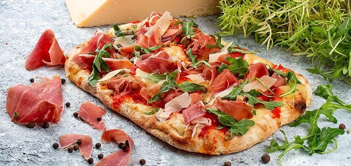 Скидка до 50% на меню кухни и пиццу с доставкой или в ресторане «Монтана»