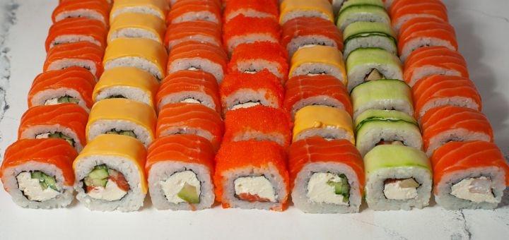 Скидка 50% на все меню роллов, сетов, пиццы и суши с доставкой или самовывозом от «Mayamy»